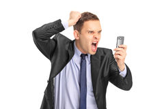 Businessperson screaming on a mobile phone Royalty Free Stock Photos