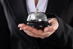 Businessperson with service bell Stock Images