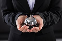 Businessperson with service bell Stock Image