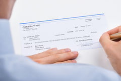 Businessperson Signing Cheque Royalty Free Stock Photography