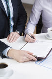 Businessperson signing important document Royalty Free Stock Image