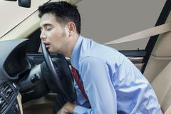 Businessperson sleeping in the car Royalty Free Stock Images