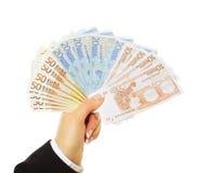 Businessperson som betalar i Euro fotografering för bildbyråer