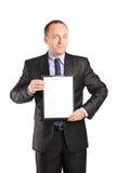 Businessperson som rymmer en skrivplatta royaltyfria bilder