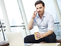 Businessperson talking on cellphone Royalty Free Stock Photos