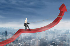 Businessperson tries to pull the arrow upward Stock Image