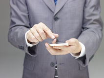 Businessperson using cellphone Royalty Free Stock Photography