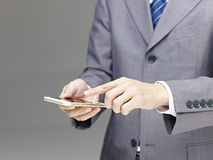 Businessperson using cellphone Stock Photography