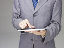 Businessperson using a tablet Royalty Free Stock Photos