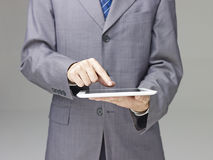 Businessperson using a tablet Royalty Free Stock Photography