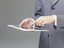 Businessperson using a tablet Stock Photos