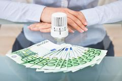 Businessperson with valve and money Stock Images