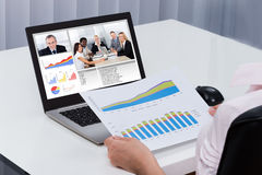 Businessperson Videoconferencing On Laptop Royalty Free Stock Photography