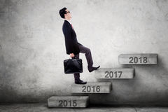 Businessperson walks toward 2017 on stairs Royalty Free Stock Photo