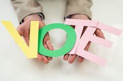 Businessperson with the word vote Royalty Free Stock Images