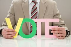 Businessperson with the word vote Royalty Free Stock Photo