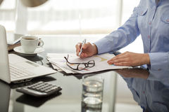 Businessperson working in office Stock Photography