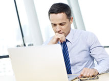 Businessperson working in office with laptop Stock Photos