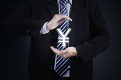 Businessperson with yen currency symbol Royalty Free Stock Image