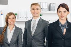 3 businesspersons стоя в линии Стоковое фото RF