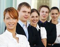 businesspersons 5 гребут детенышей Стоковое Фото