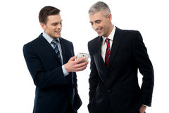 Businesspersons looking at the mobile phone Royalty Free Stock Photography