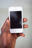 Businesspersonsmartphone med den spruckna skärmen Royaltyfri Fotografi