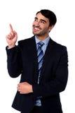 Businesss executive pointing upwards Royalty Free Stock Photos