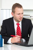 Businesss man with lack of concentration Royalty Free Stock Photos