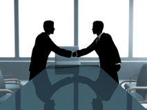 Businesss meeting. Two businessmen shake hands in the office Royalty Free Stock Image