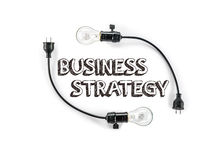 Businesss strategy phrase and light bulb, hand writing, Marketin Royalty Free Stock Photos