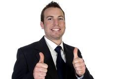 businesssman愉快的显示的thumbsup年轻人 免版税库存图片