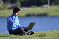 Businesssman with laptop Royalty Free Stock Photos