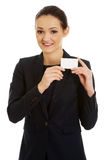Businessswoman holding empty card. Royalty Free Stock Photo