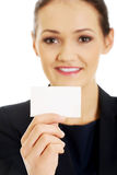 Businessswoman holding empty card. Royalty Free Stock Image