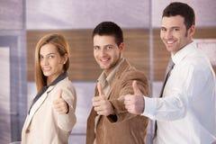 Businessteam acertado que sonríe feliz Imagen de archivo