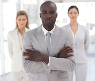 Businessteam with african-american leader stock images