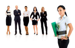Businessteam with a businesswoman leading it. Isolated over a white background royalty free stock photo