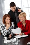 Businessteam busy working Royalty Free Stock Photography