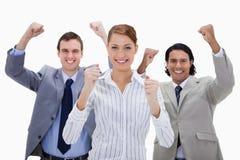 Businessteam con los brazos levantados Fotografía de archivo libre de regalías