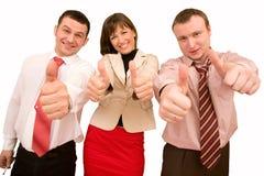 Businessteam in den formalen Klagedaumen oben Lizenzfreies Stockfoto