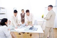 Businessteam in der Arbeit Stockfotos