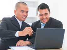 Businessteam discussion. Southeast Asian businessteam discuss in office Royalty Free Stock Images