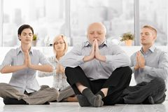 Businessteam doing yoga meditation Royalty Free Stock Images