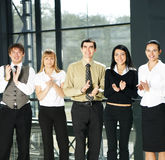 A businessteam of five young persons Stock Image