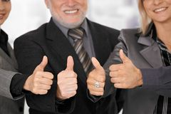 Businessteam giving thumb up. Royalty Free Stock Photography