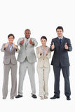 Businessteam giving thumbs up together Stock Photography