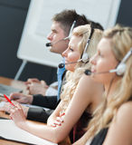 Businessteam with headphones Stock Images