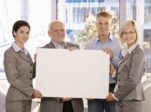 Businessteam holding blank poster for copy space Stock Photography