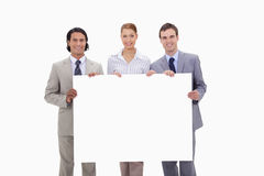Businessteam holding blank sign Stock Images